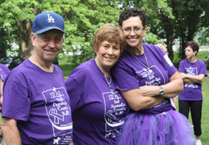 Christi Thompson Merritt (right) with her uncle Charlie and aunt Carolyn Deterring, at Walk with the Dogs 5K last year. They host the event in memory of Merritt's mother and Carolyn's sister, Jeanenne Thompson, who loved dogs.