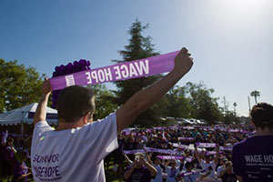 Two-year survivor Nester Gomez leads the Wage Hope rallying cry from the PurpleStride Los Angeles stage.
