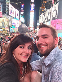 Allison and Todd snapping a selfie in Times Square in New York City.