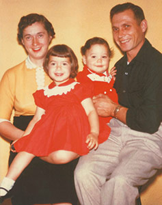 Pamela Acosta Marquardt with her mother, Rose, her brother, Mike and her father, Herman Schneider, in 1956.