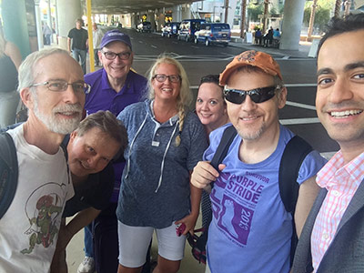 Drs. Beg (right) and Boothman (second from left) with the Dallas-Fort Worth cohort of volunteers arriving for the Annual Scientific Meeting and Community Engagement Leadership Training events.
