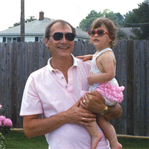 A young Bryant spends time with her dad out in their garden.
