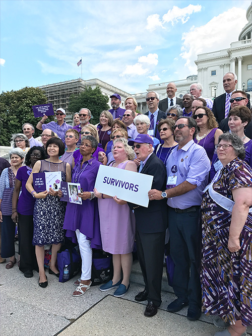 Over 100 pancreatic cancer survivors stand together on the steps of the U.S. Capitol for the 10th anniversary of Advocacy Day