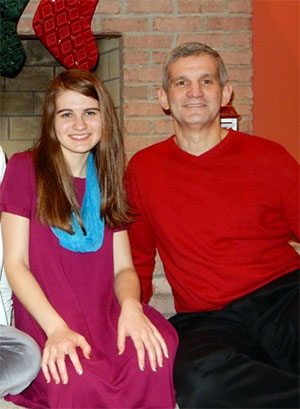 Teenage daughter and volunteer Nikki Cronin with her father Dennis, a seven-year survivor.