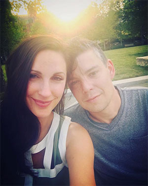 Jennifer and Justin Baker in a sunny park just after his diagnosis of pancreatic cancer
