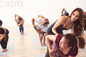 Students of diverse backgrounds attend Lauren Eckstrom's yoga class for compassionate support