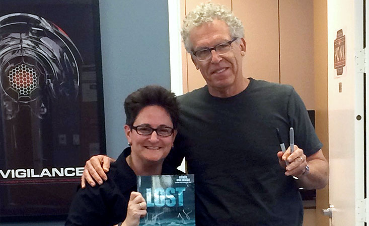 """Jo Garfein holds signed Lost collectible with the show's screenwriter with """"LOST"""" Show Runner Carlton Cuse"""