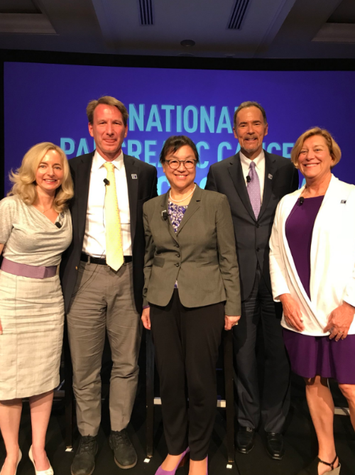 Four experts stand with PanCAN president and CEO for the scientific panel on pancreatic cancer.