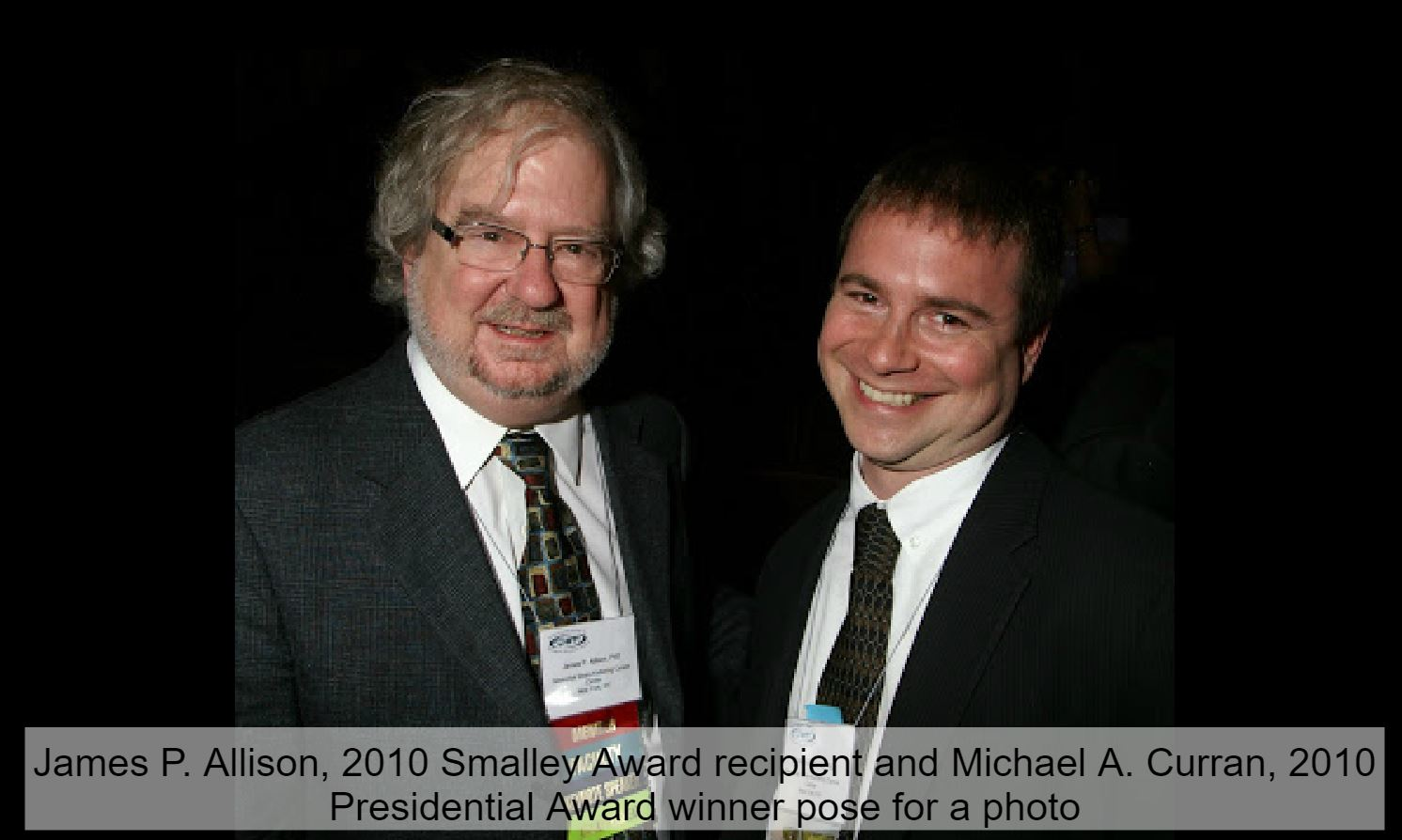 Two male scientists who are award-winning cancer immunotherapy experts.