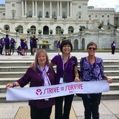 "Three female pancreatic cancer survivors hold ""strive to survive"" sign at the Capitol building."
