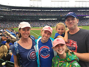 Supporter of pancreatic cancer cause with his wife and three daughters at Chicago Cubs game.