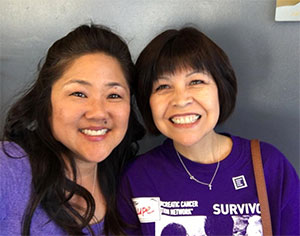 PanCAN staff member smiling with passionate volunteer Lupe Romero