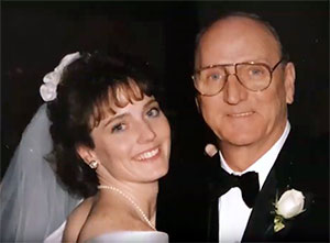 Daughter at her wedding with her father who she lost to pancreatic cancer in 2013