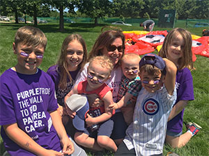 12-year survivor with grandkids at PurpleStride Chicago 2018, the walk to end pancreatic cancer