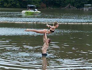 Attendees at the Dirty Dancing Festival try to reenact the famous lake-lift scene from the movie