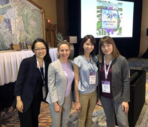 Three pancreatic cancer researchers with PanCAN CEO Julie Fleshman at scientific conference