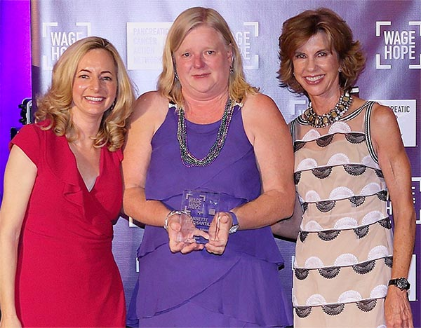 PanCAN volunteer receiving award from PanCAN President and Board of Directors Chair