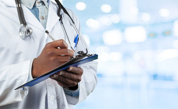 African-American oncologist reviews new ASCO pancreatic cancer guidelines on tablet