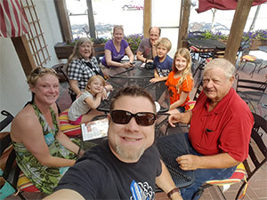 Stage IV pancreatic cancer survivor enjoying time with his wife, children and grandchildren