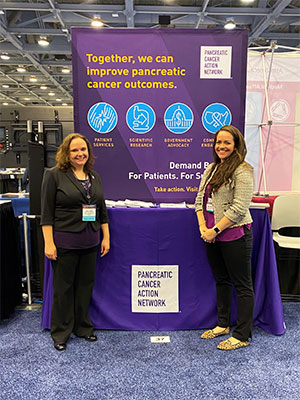 Pancreatic cancer patient advocacy staff in front of PanCAN exhibit booth at major conference
