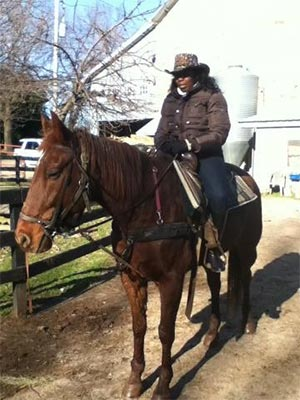 Volunteer and longtime pancreatic cancer survivor and her horse