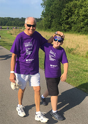 Stage cancer survivor and his grandson at pancreatic cancer walk