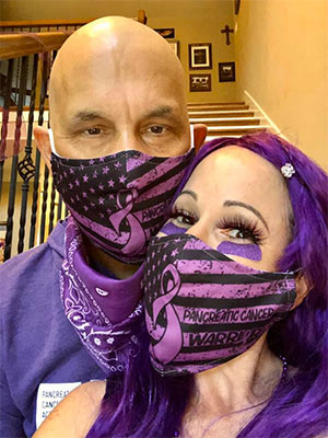 Stage 4 pancreatic cancer survivor and caregiver wear purple masks during COVID-19 pandemic
