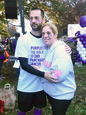 Husband and wife at PanCAN PurpleStride event.