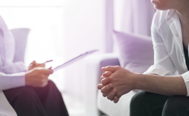 A pancreatic cancer patient and their doctor discuss new, innovative clinical trials