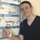 Hospital patient about to be discharged, standing by white board